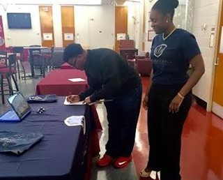 Sophia Ephraim, Founder and President of the Chapter at North Carolina Central University, tables at her school to recruit new members into a community that will last a lifetime! ?#?NCCU? ?#?Recruitment?